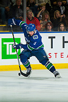 KELOWNA, BC - SEPTEMBER 29: Derrick Pouliot #5 of the Vancouver Canucks skates with the puck against the Arizona Coyotes  at Prospera Place on September 29, 2018 in Kelowna, Canada. (Photo by Marissa Baecker/NHLI via Getty Images)  *** Local Caption *** Derrick Pouliot