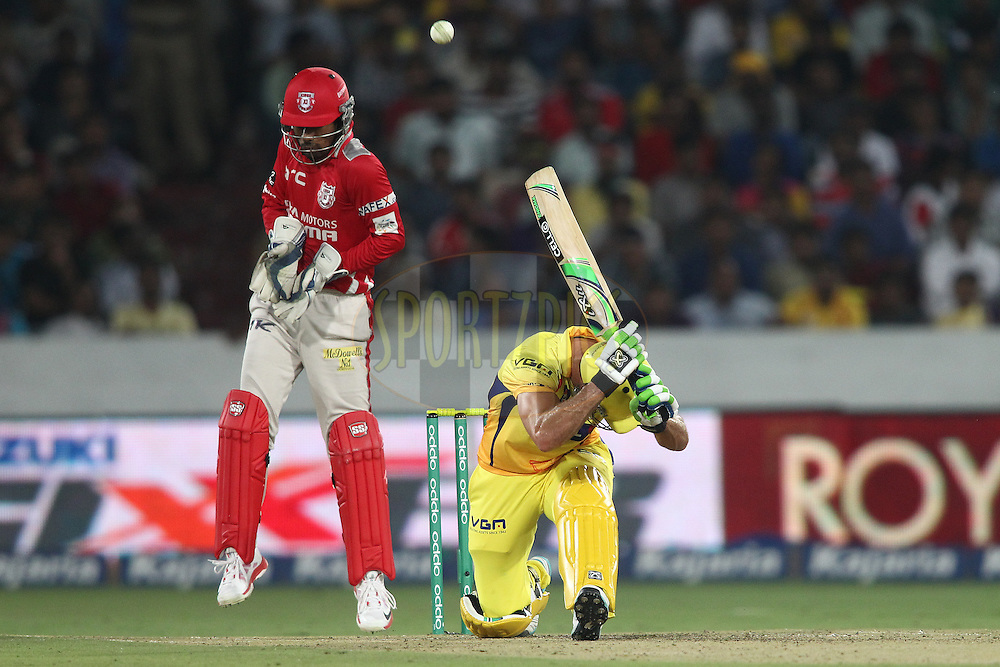 Francois Du Plessis of the Chennai Super Kings miss times his scoop shot during the second semi final match of the Oppo Champions League Twenty20 between the Kings XI Punjab and the Chennai Superkings held at the Rajiv Gandhi Cricket Stadium, Hyderabad, India on the 2nd October 2014<br /> <br /> Photo by:  Shaun Roy / Sportzpics/ CLT20<br /> <br /> <br /> Image use is subject to the terms and conditions as laid out by the BCCI/ CLT20.  The terms and conditions can be downloaded here:<br /> <br /> http://sportzpics.photoshelter.com/gallery/CLT20-Image-Terms-and-Conditions-2014/G0000IfNJn535VPU/C0000QhhKadWcjYs