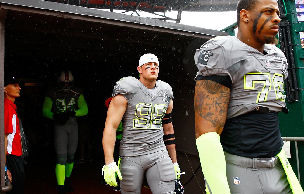J.J. Watt walks out of the tunnel before kickoff of the 2014 Pro Bowl at Aloha Stadium on Sunday, January 26, 2014, in Honolulu. (AP Photo/Michael Yanow)