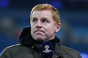 Ex Bolton Wanderers Manager Neil Lennon working for Television during the Champions League Round of 16 match between Manchester City and Dynamo Kiev at the Etihad Stadium, Manchester, England on 15 March 2016. Photo by Simon Davies.