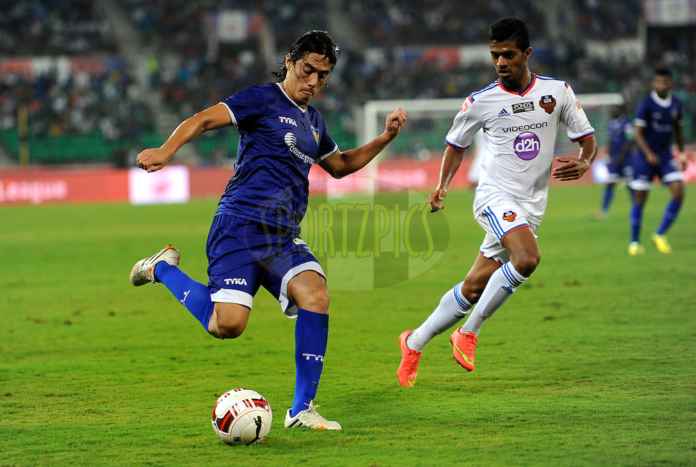Jairo Andres Suarez Carvajal of Chennaiyin FC and Mandar Rao Dessai of FC Goa during match 50 of the Hero Indian Super League between Chennaiyin FC and FC Goa held at the Jawaharlal Nehru Stadium, Chennai, India on the 5th December 2014.<br /> <br /> Photo by:  Pal Pillai/ ISL/ SPORTZPICS