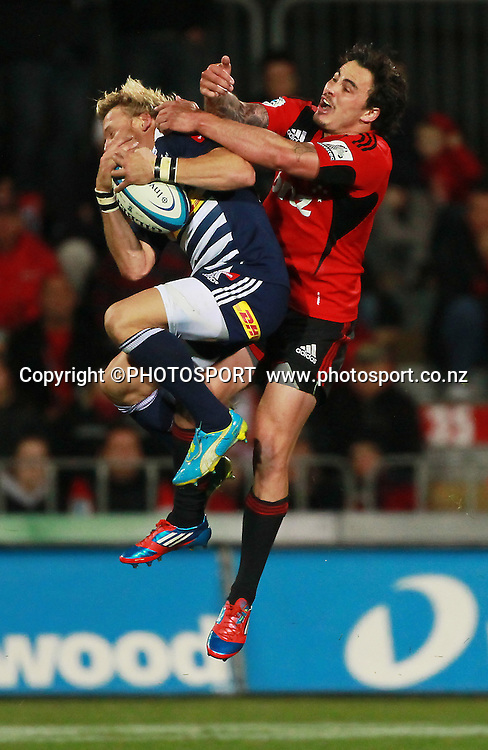 Zac Guildford jumps for the ball for the Crusaders with Stormers full back Johan Christiaan Pietersen. Super Rugby game between the Crusaders and the Stormers. Crusaders new Christchurch Stadium at Rugby League Park, Saturday 14 April 2012. Photo : Joseph Johnson / photosport.co.nz