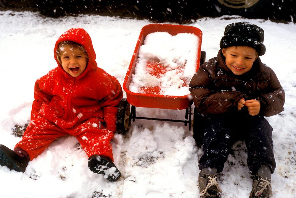 Barrow, Alaska. Siblings Juliana and James Aikins playing on the snow. MR
