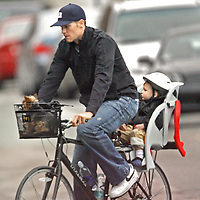 Tom Brady and son John Moynahan, bicycle in and around Boston. Photo by Mark Garfinkel