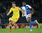 Joe Newell (Rotherham United) runs with the ball past Hope Akpan (Blackburn Rovers) during the Sky Bet Championship match between Blackburn Rovers and Rotherham United at Ewood Park, Blackburn, England on 11 December 2015. Photo by Mark P Doherty.