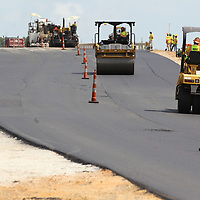 Paving crews work to complete the new interchange at U.S. Highway 6 and Thomas Street in Tupelo Tuesday.