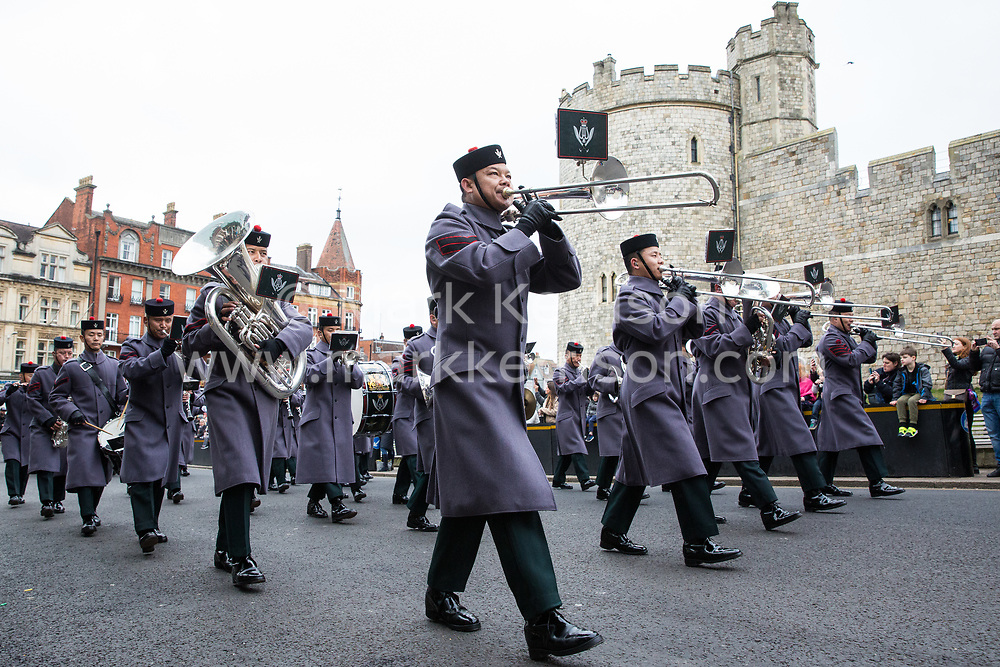 Windsor, UK. 21st February, 2019. The Band of the Brigade of Gurkhas leads 36 Engineer Regiment Queen's Gurkha Engineers in the Changing of the Guard ceremony at Windsor Castle. The Queen's Gurkha Engineers will provide the Windsor Guard until April 12th, for the first time since the celebrations marking 200 years of service to the Crown in 2015.