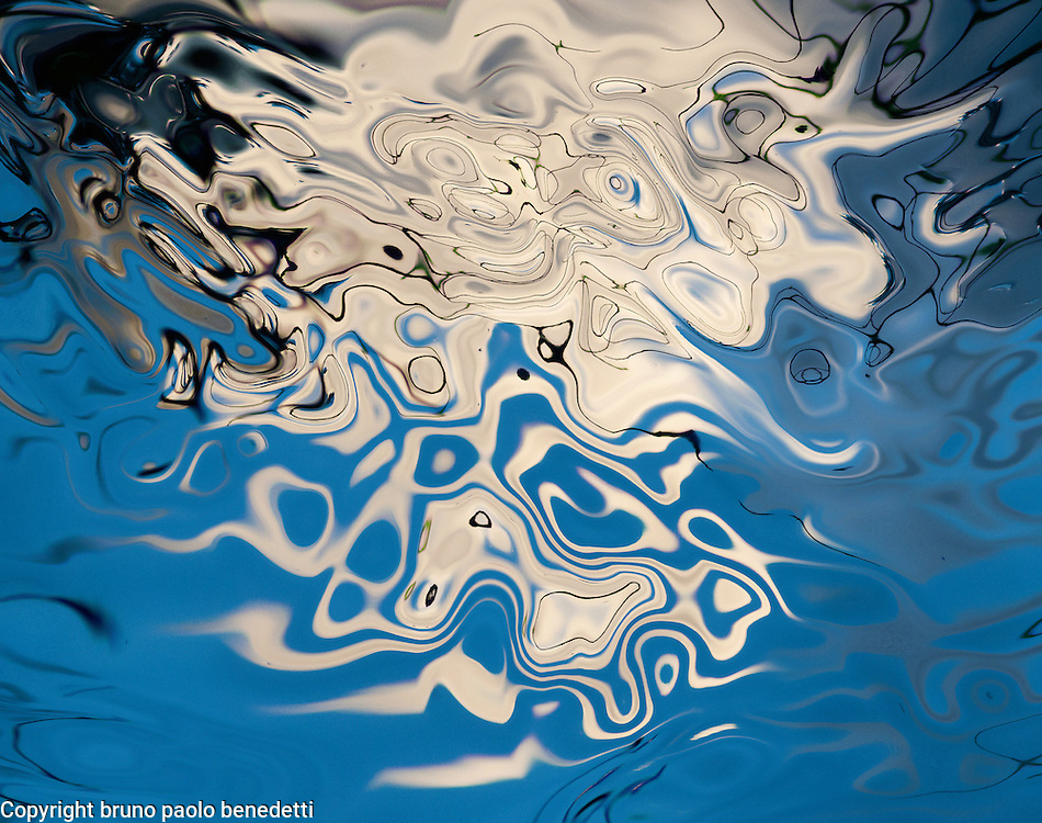 white and blue abstractions with many shades of blue and tones of white in a fluid floating shape.