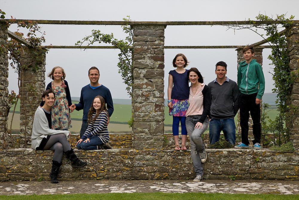 The Elliott and Baker families in the rose arbour at Pickwell Manor. From left to right: Tracey Elliott, Millie-grace Elliott (8), Richard Eliott, Molly Elliott (10), Liza Baker (9), Susannah Baker, Steve Baker, Zac Baker (11). Pickwell Manor, Georgeham, North Devon, UK.<br /> CREDIT: Vanessa Berberian for The Wall Street Journal<br /> HOUSESHARE