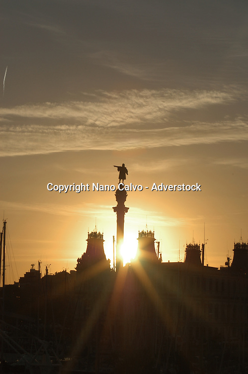 Monument to Christopher Colombus in Colombus Square, or Plaza de Colon, at the end of the popular Ramblas, at sunset, in Barcelona, Spain © Nano Calvo - V&W