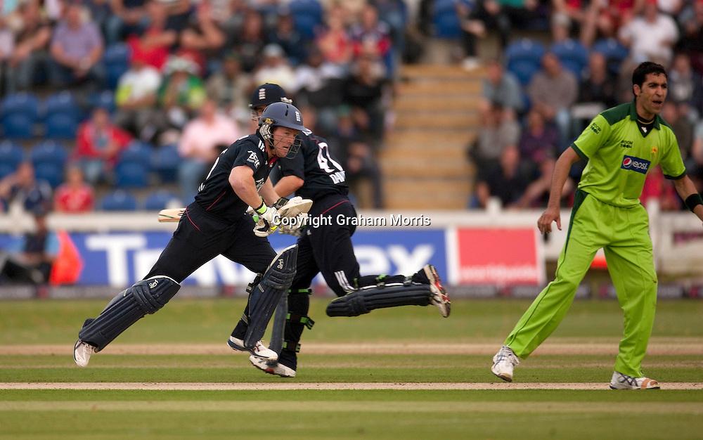 Eoin Morgan runs past bowler Umar Gul the first T20 international between England and Pakistan in Cardiff.  Photo: Graham Morris (Tel: +44(0)20 8969 4192 Email: sales@cricketpix.com) 05/09/10