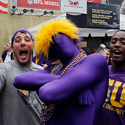 Jan 9, 2012; New Orleans, LA, USA; LSU Tigers fans pose for a photo before the 2012 BCS National Championship game between Alabama Crimson Tide at the Mercedes-Benz Superdome.  Mandatory Credit: Derick E. Hingle-US PRESSWIRE
