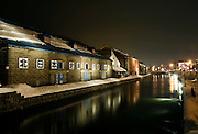 Photo shows the canal and old stone warehouse in Otaru, Hokkaido, Japan on 09 Feb. 2010. The area, now a popular tourist destination sporting craft shops, cafes and a beer hall, used to be the center of the town's busy port in the early 20th century.