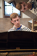 Nathan Sumrall rehearses in Saint John's Episcopal Church before his concert on December 21, 2016