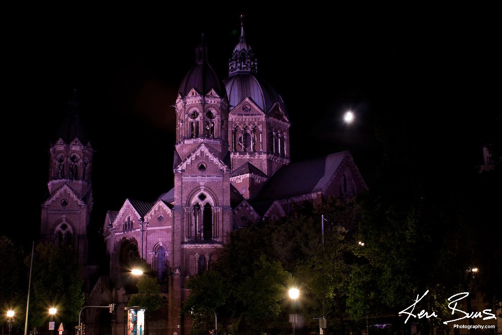 St. Lukas Church, illuminated at night from the banks of the Isal River. The Evangelical Lutheran Church of St. Luke was built in the late 1890's and is one of the only preserved Protestant parish church's in Munich.