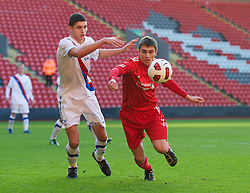 LIVERPOOL, ENGLAND - Saturday, January 8, 2011: Liverpool's Adam Morgan and Crystal Palace's Ryan Inniss during the FA Youth Cup 4th Round match at Anfield. (Pic by: David Rawcliffe/Propaganda)