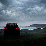 Porsche Macan on cliff top looking out to the stormy sea under dramatic cloud Ray Massey is an established, award winning, UK professional  photographer, shooting creative advertising and editorial images from his stunning studio in a converted church in Camden Town, London NW1. Ray Massey specialises in drinks and liquids, still life and hands, product, gymnastics, special effects (sfx) and location photography. He is particularly known for dynamic high speed action shots of pours, bubbles, splashes and explosions in beers, champagnes, sodas, cocktails and beverages of all descriptions, as well as perfumes, paint, ink, water – even ice! Ray Massey works throughout the world with advertising agencies, designers, design groups, PR companies and directly with clients. He regularly manages the entire creative process, including post-production composition, manipulation and retouching, working with his team of retouchers to produce final images ready for publication.