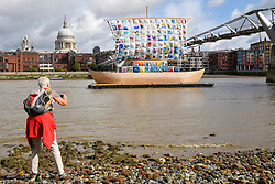 "© Licensed to London News Pictures. 04/09/2019. LONDON, UK. A tourist takes a photo during the photocall for the launch of ""The Ship of Tolerance"" at Tate Modern, Bankside.  The floating installation by Emilia Kabakov (of Russian conceptual artist duo Ilya and Emilia Kabakov) forms part of Totally Thames Festival and will be moored 4 September to 31 October.  The goal of the artwork is to educate and connect the youth of the world through the language of art.  Photo credit: Stephen Chung/LNP"