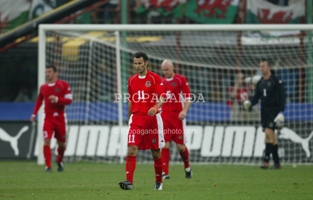 MILAN, ITALY - Saturday, September 6, 2003: Wales' Ryan Giggs and players walk back dejected after Italy third goal during the Euro 2004 qualifying match at the San Siro Stadium. (Pic by David Rawcliffe/Propaganda)