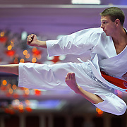 USA Junior National Karate Team member Gregory Rummel warming up during the 2014 USA Karate National Championships and Team Trials at the Peppermill Resort, Reno, NV, on July 10, 2014.  © 2014 Shelley Lipton.