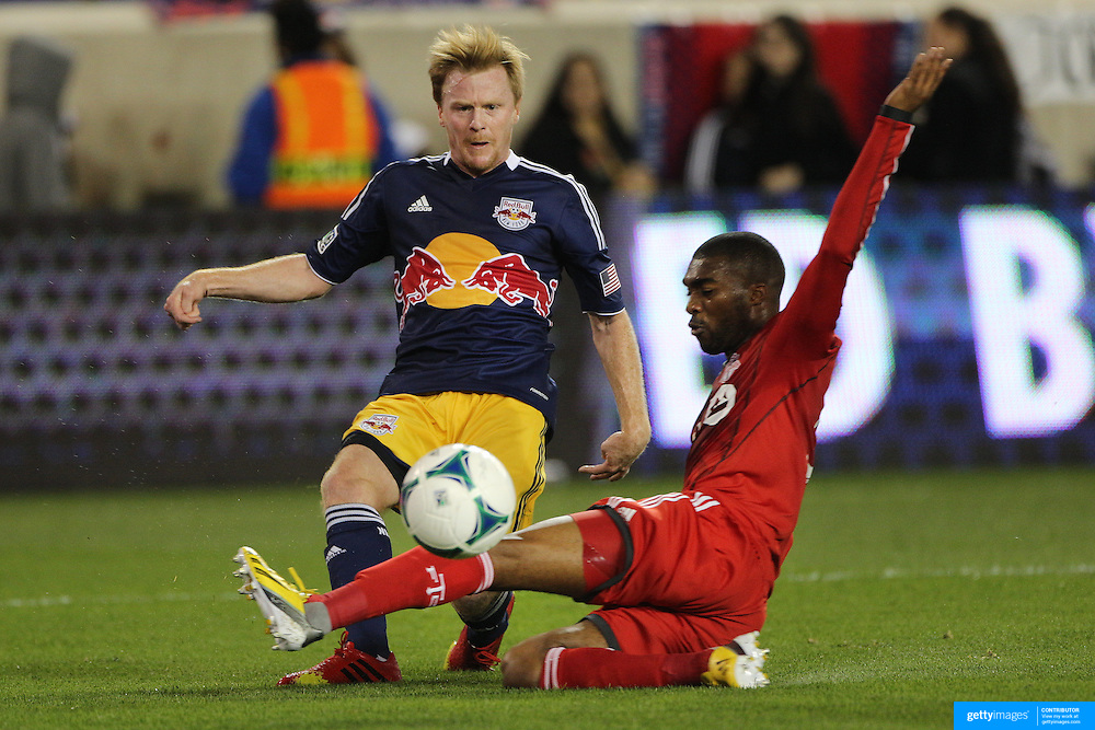 Dax McCarty, New York Red Bulls, crosses to Thierry Henry for the first goal during the New York Red Bulls V Toronto FC, Major League Soccer, regular season match at Red Bull Arena, Harrison, New Jersey. USA. 14th September 2013. Photo Tim Clayton