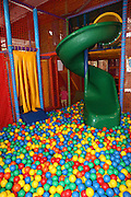 Indoor children's playground a slide in an empty ball pool