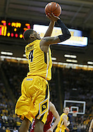 January 19 2013: Iowa Hawkeyes guard/forward Roy Devyn Marble (4) puts up a shot during the first half of the NCAA basketball game between the Wisconsin Badgers and the Iowa Hawkeyes at Carver-Hawkeye Arena in Iowa City, Iowa on Sautrday January 19 2013. Iowa defeated Wisconsin 70-66.