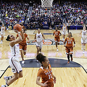 UNCASVILLE, CONNECTICUT- DECEMBER 4: Saniya Chong #12 of the Connecticut Huskies drives to the basket during the UConn Huskies Vs Texas Longhorns, NCAA Women's Basketball game in the Jimmy V Classic on December 4th, 2016 at the Mohegan Sun Arena, Uncasville, Connecticut. (Photo by Tim Clayton/Corbis via Getty Images)