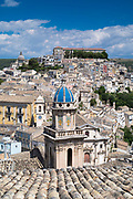 Aerial view of Ragusa Ibla famous hill town with Santa Maria delli'Idria a Baroque style church in foreground, Sicily