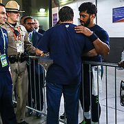 Seahawks quarterback Russell Wilson greets Patriots coach Bill Belichick in a hallway as the Patriots coach carries the Lombardi Trophy from the field at University of Phoenix Stadium during Super Bowl XLIX on Sunday, February 1, 2015 in Phoenix, Arizona.  (Joshua Trujillo, seattlepi.com)