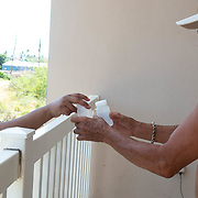 JULY 21, 2018---ARECIBO, PUERTO RICO---<br /> CUNY student intern Alondra Cruz Portillo, hands Alberto Escobar, 69, bottles to collect samples of water.<br /> (Photo by Angel Valentin/Freelance)