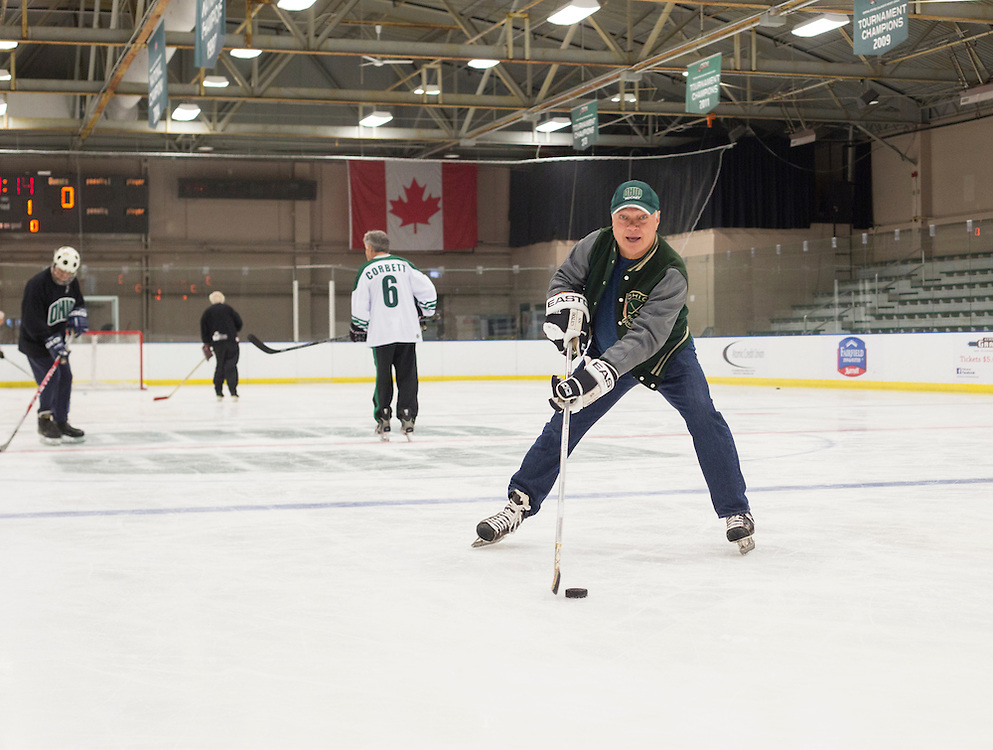 Tom Gosiorowski skates with other 1960s hockey alumni at Bird Arena during their reunion weekend on October 1, 2016.