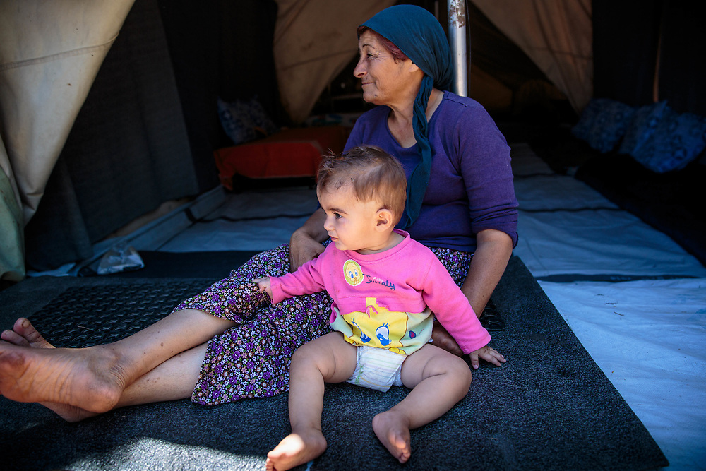 Afadee and her grandson, Deyar, 1, are Syrian Kurdish refugees from Aleppo, Syria.  They and their extended family have been living in Ritsona for four months. Ritsona Refugee Camp, Greece, July 2016.