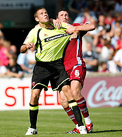 Photo: Steve Bond.<br />Scunthorpe United v Sheffield United. Coca Cola Championship. 01/09/2007. James Beattie (L) receives some close attention from Cliff Byrne (R)