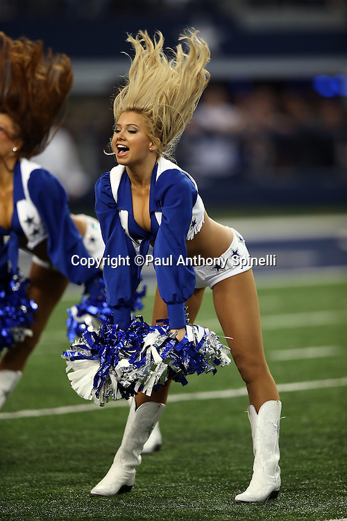 A Dallas Cowboys cheerleader flips her blonde hair as she does a dance routine before the NFL week 18 NFC Wild Card postseason football game against the Detroit Lions on Sunday, Jan. 4, 2015 in Arlington, Texas. The Cowboys won the game 24-20. ©Paul Anthony Spinelli