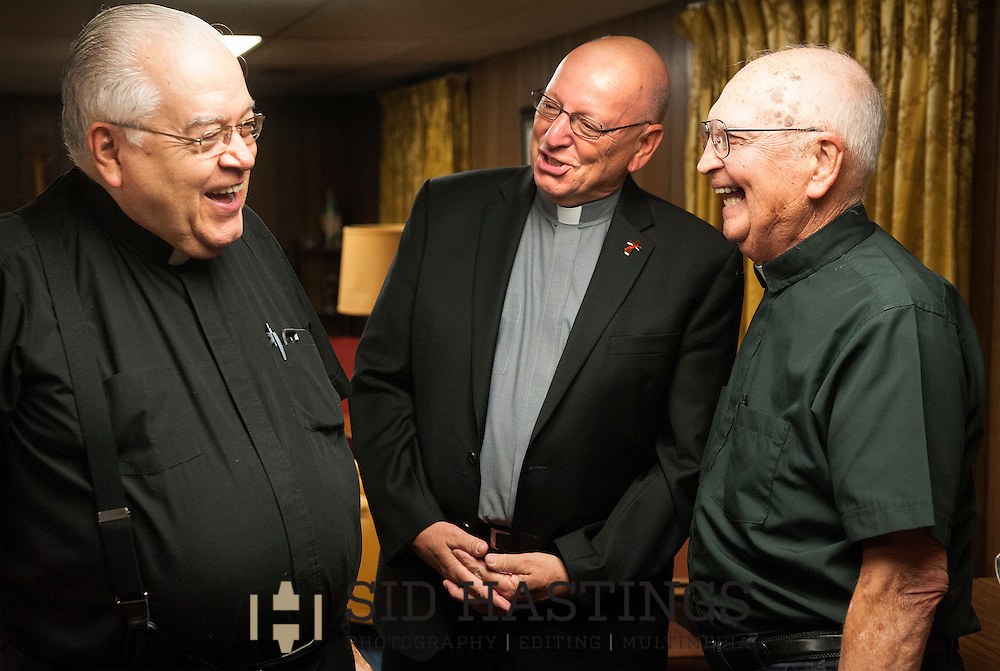 28 JULY 2015 -- ST. CHARLES, Mo. -- Deacon John Schiffer (center), newly-appointed Parish Life Coordinator at St. Robert Bellarmine Catholic Church in St. Charles, Mo., visits with Monsignor Robert P. Jovanovic (left), of St. Elizabeth Ann Seton Parish, and Monsignor Ray Hampe, in residence at St. Robert Bellarmine, following a meeting of clergy and staff at the parish Tuesday, July 27, 2015. Schiffer is teaming with Father Mark Whitman to lead the parish with the departure of previous pastor Father Patrick Ryan. Photo © copyright 2015 Sid Hastings.