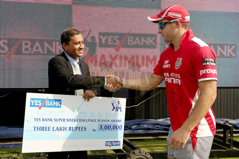 David Miller receives a cheque for the Yes Bank Super Sixes Award from Group President, Corporate Banking, of Yes Bank Amit Kumar during the first qualifier match (QF1) of the Pepsi Indian Premier League Season VII 2014 between the Kings XI Punjab and the Kolkata Knight Riders held at Eden Gardens Cricket Stadium, Kolkata, India on the 28th May 2014. Photo by Jacques Rossouw / IPL / SPORTZPICS<br /> <br /> <br /> <br /> Image use subject to terms and conditions which can be found here:  http://sportzpics.photoshelter.com/gallery/Pepsi-IPL-Image-terms-and-conditions/G00004VW1IVJ.gB0/C0000TScjhBM6ikg