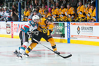 KELOWNA, CANADA - MAY 13: Dillon Dube #19 of Kelowna Rockets checks Eric Roy #7 of Brandon Wheat Kings on May 13, 2015 during game 4 of the WHL final series at Prospera Place in Kelowna, British Columbia, Canada.  (Photo by Marissa Baecker/Shoot the Breeze)  *** Local Caption *** Eric Roy; Dillon Dube;