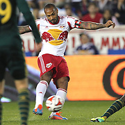 Thierry Henry, New York Red Bulls, shoots during the New York Red Bulls Vs Portland Timbers, Major League Soccer regular season match at Red Bull Arena, Harrison, New Jersey. USA. 24th May 2014. Photo Tim Clayton