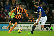 Abel Hernandez (left) of Hull City and Phil Jagielka of Everton during the Barclays Premier League match at KC Stadium, Hull<br /> Picture by Richard Gould/Focus Images Ltd +44 7855 403186<br /> 01/01/2015