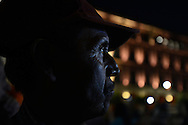 México City - Elementary school teacher Rito Nolazco, from Santamaría Ocotlan village in the state of Durango, watches the presidential candidates debate on a big screen in Main Plaza known as Zocalo. The viewing was part of a rally organized by the grassroots #YoSoy132 movement. The teacher slept in the plaza and started his own protest with fellow teachers the next morning. (PHOTO: MIGUEL JUAREZ LUGO)