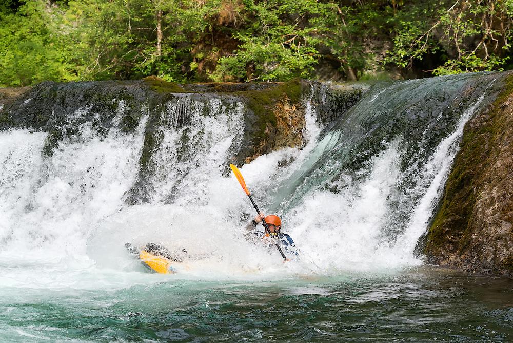 Running Salmon Creek Falls in an inflatable kayak, Oregon.