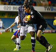 Picture by David Horn/Focus Images Ltd +44 7545 970036<br /> 28/01/2014<br /> Danny Shittu of Millwall clashes with his goalkeeper Stephen Bywater of Millwall during the Sky Bet Championship match at The Den, London.