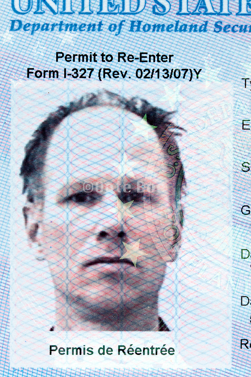 ID photo document on an USA reentry permit passport