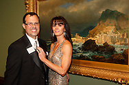 Michael and Dr. Lori Vavul-Roediger in front of one of her favorite pieces, 'Porto Venere, Spezia, Italy' by William Stanley Haseltine, an oil on canvas circa 1878 during the 56th Art Ball, 'Art is in the Air', at the Dayton Art Institute, Saturday, June 8, 2013.