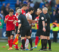 CARDIFF, WALES - Saturday, March 22, 2014: Liverpool's Luis Suarez picks up the match-ball from the referee after his hat-trick help the Reds defeat Cardiff City 6-3 during the Premiership match at the Cardiff City Stadium. (Pic by David Rawcliffe/Propaganda)