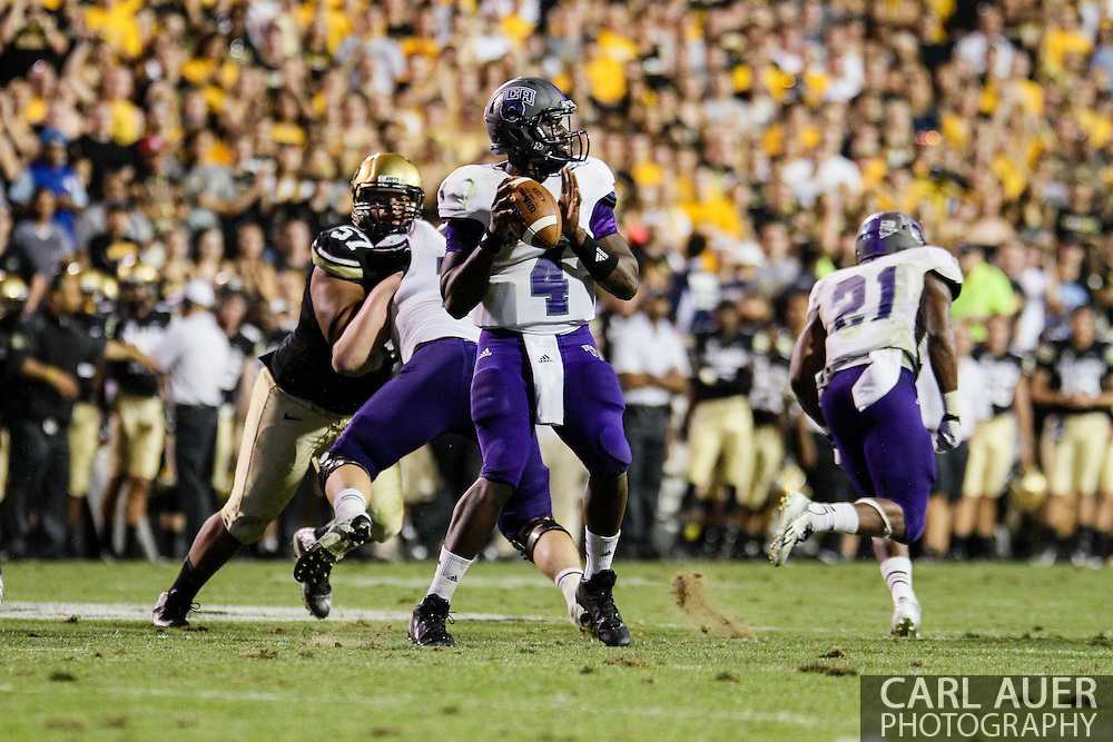 September 7th, 2013 - University of Central Arkansas Bears senior quarterback Wynrick Smothers (4) looks to pass the ball in the fourth quarter of the NCAA football game between the University of Central Arkansas Bears and the University of Colorado Buffaloes at Folsom Field in Boulder, CO