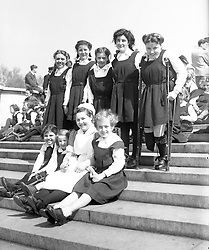 Children from the Halliwick Cripple School, Winchmore Hill, had a grandstand view of the State Drive from the Victoria Memorial, opposite Buckingham Palace. (L-R, standing) Pauline Harrison, 16, of Barnsley, Jean Darwin, 14, of Sheffield, Margaret Mather, 10, of Dalton, Jean Backhouse, 14, of Wakefield, and Molly Chadwick, 15, of Barnsley. (L-R, seated) Pamela Rollinson, 8, of Doncaster, Valerie Fawbert, 6, of Bradford, Nurse E. Hutton and Audrey Murr, 10, of Leeds.