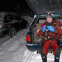 Photographer Magnus Lundgren at work in Trondheimsfjorden, Norway<br /> Model release by photographer