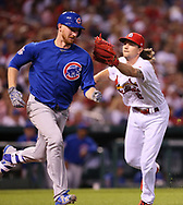 May 12, 2017 - St Louis, MO, USA - St. Louis Cardinals starting pitcher Mike Leake tags out Chicago Cubs' Eddie Butler on a sacrifice bunt in the fourth inning on Friday, May 12, 2017, at Busch Stadium in St. Louis, Mo. (Credit Image: © Chris Lee/TNS via ZUMA Wire)